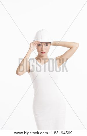 Conceptual fashion photography of sexy girl structural engineer on white background