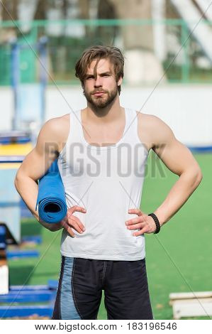 Muscular Man Holding Yoga Or Fitness Mat For Exercise