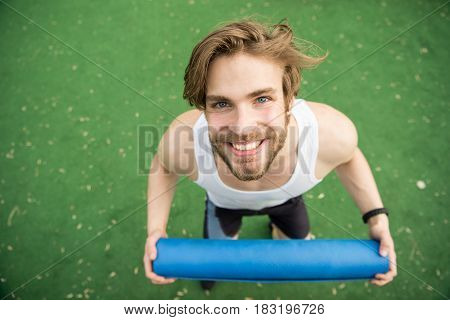 Happy Man With Muscular Body Holding Yoga Or Fitness Mat