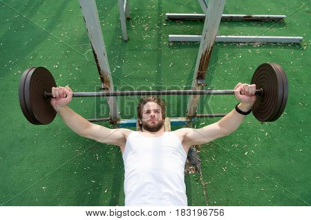Muscular Man Workout In Gym Doing Exercises With Barbell