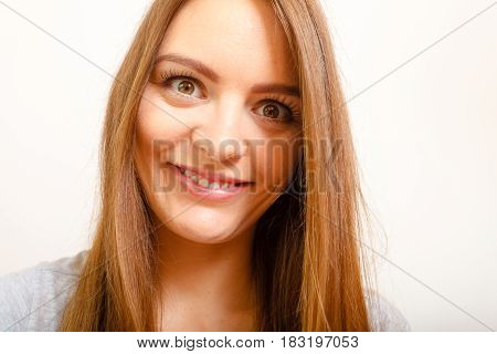 Crazy happy concept. Happy psycho woman smiling in creepy way close up of her face
