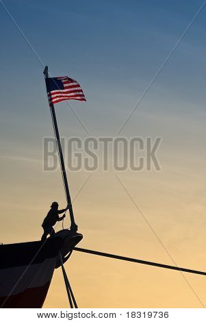 American Flag Raised On Bow Of Ship