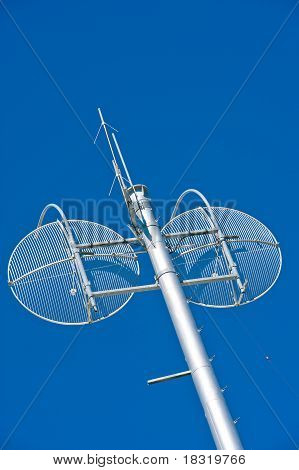 Communications Tower With Twin Wire Sattelite Dishes