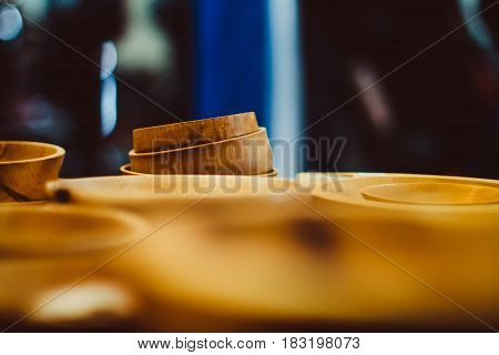 a wooden bowl standing on the counter