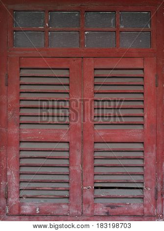 Grunge and dusty red wooden window, architecture concept