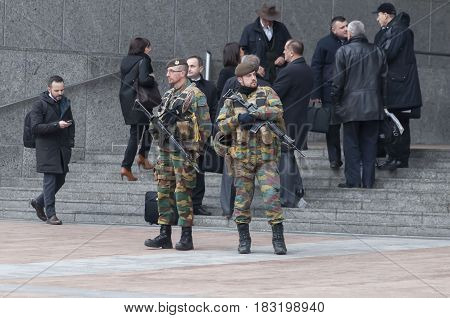Belgian guards protecting the entrance of the European Parliament main building in Brussels (Bruxelles), Belgium. Brussels terror attacks stock photo. Stock image. January 2016