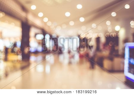 Blurred Background: People Shopping At Mall With Bokeh Light