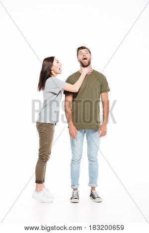 Happy woman choking her man with opened mouth isolated over white background