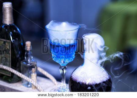 Blue smoke bottle containing witches brew, mana replenishment.