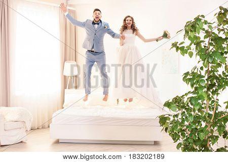 Happy wedding couple having fun at home