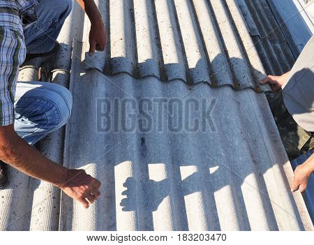 Roofer Repair and Replace Dangerous Asbestos Old Roof Tiles. Asbestos removal.