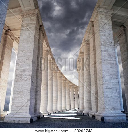 White stone columns against the sky. The Colonnade in Rome