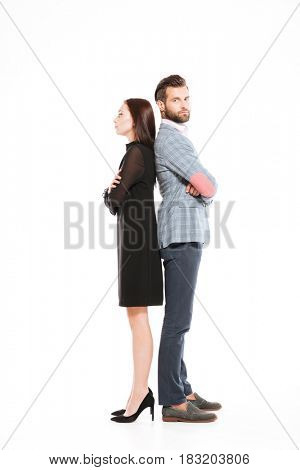 Photo of young offended loving couple standing isolated over white background.