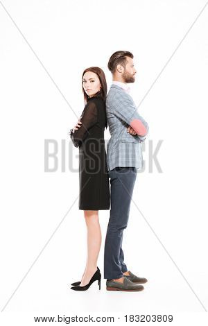 Image of young offended loving couple standing isolated over white background.