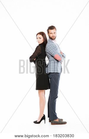 Image of young offended loving couple standing isolated over white background. Looking at camera.