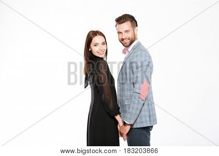 Image of young happy loving couple standing isolated over white background. Looking at camera.