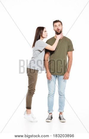 Angry woman choking her man isolated over white background