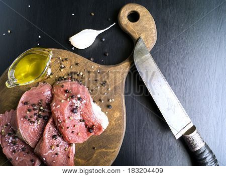 Raw Meat. Raw Beef Steak On Cutting Board And Spices.