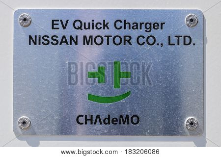 Indianapolis - Circa April 2017: Electric Vehicle Quick Charger at a local Nissan Car Dealership. The Nissan LEAF EV is a best-selling vehicle II