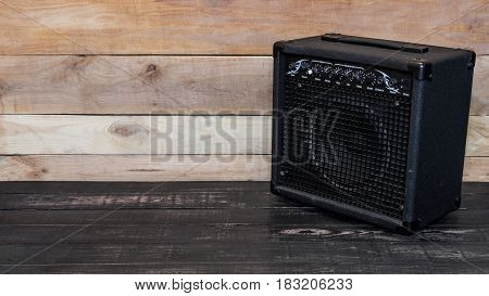Electric Guitar Amplifier On Wooden Background