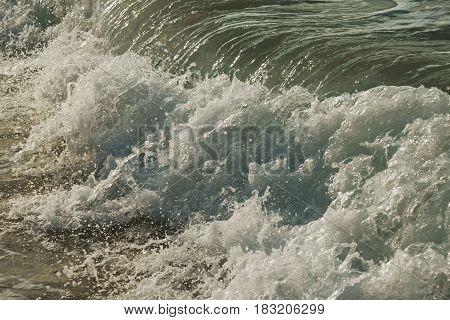 Beautiful waves of the South China Sea on Dadonghai beach.