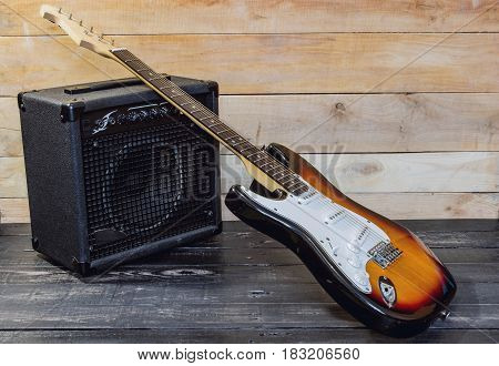Electric Guitar With Amplifier On Wooden Planks