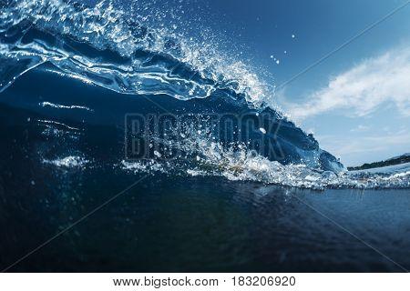 Blue ocean wave breaking on the tropical beach