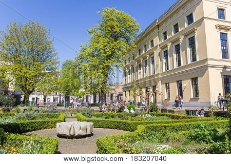 UTRECHT, NETHERLANDS - APRIL 09, 2017: People enjoying the sun in Pandhof Sinte Marie in Utrecht, Holland