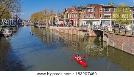 UTRECHT, NETHERLANDS - APRIL 09, 2017: Tourists in a canoe in the historic canals of Utrecht, Holland