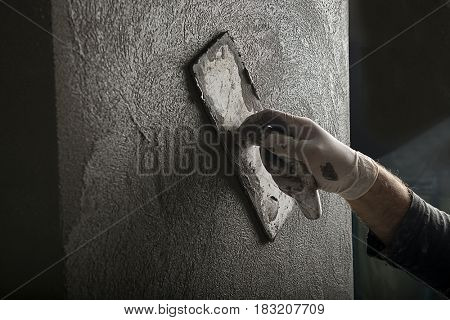 Worker Painting with Trowel Close-up