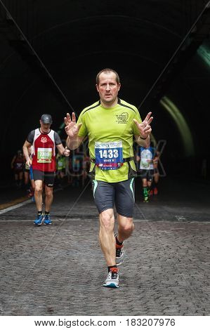 Rome Italy - April 2nd 2017: One athlete of the 23rd Rome Marathon to the passage of the tunnel Umberto I a few kilometers from the finish.