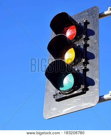 Close up of traffic lights against bright blue sky