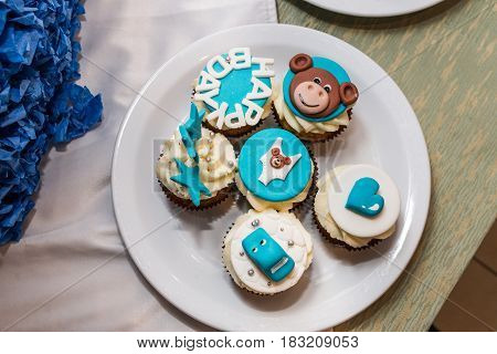 White and blue cupcakes for children's birthday
