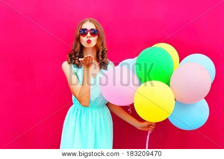 Beautiful Woman Is Sends An Air Kiss Holds An Air Colorful Balloons On A Pink Background