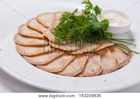 Slices Of Boiled Beef Tongue On A White Plate