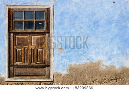 Old Brown Door On Blue Wall Background