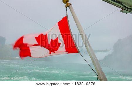 Canadian flag on a boat at Niagara Falls