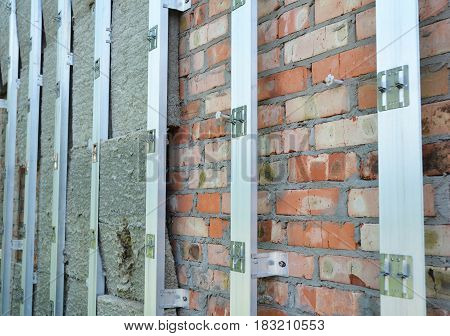 Insulating Construction. House brick wall insulation for energy saving. Renovation and insulation residential house. Insulation house.