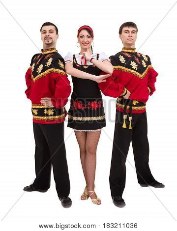 two men and one woman wearing a folk russian costume posing against isolated white background