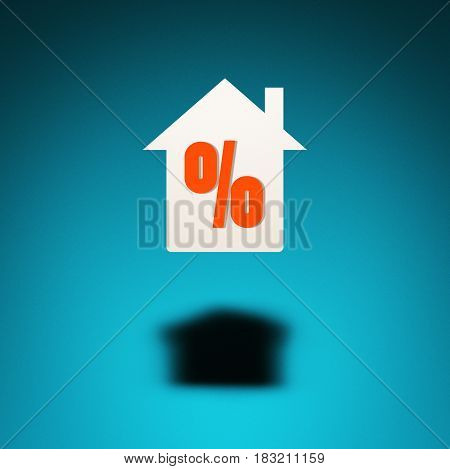 Home on credit or mortgage. An icon of a house hovers in the air casting a shadow on blue background. The symbol