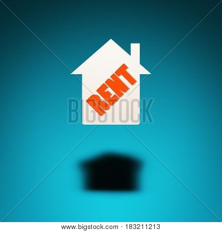 Rental property. An icon of a house hovers in the air casting a shadow on blue background. The word