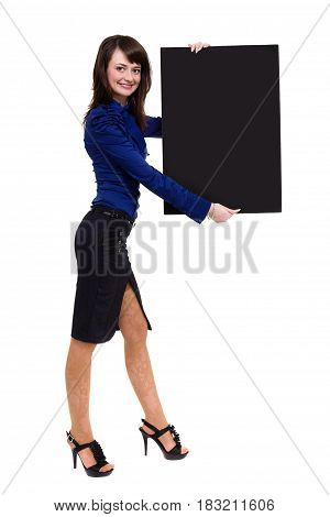 Smart young woman holding blank board ready for your text. Isolated on white background in full length.