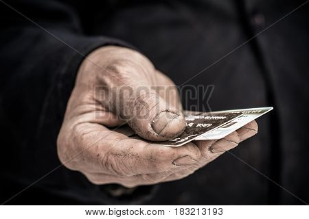 In the hands of man clamped a credit card