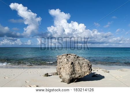 The beach view with a stone on Grand Turk island (Turks and Caicos Islands).