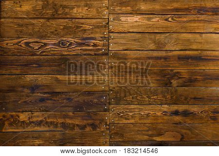 Wall of boards with nails. Twigs, texture