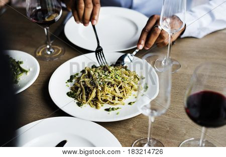 Hands Holding Knife and Fork Getting Food From Dish