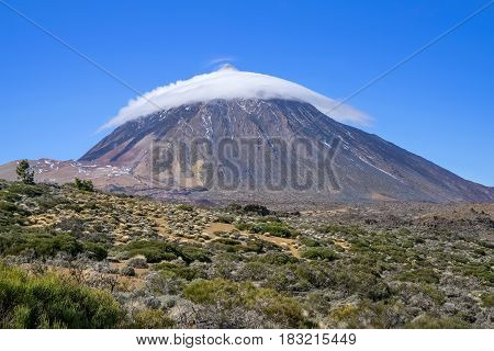 Teide with cloud cap of a lenticularis cloud in Tenerife, Canary Islands, Spain