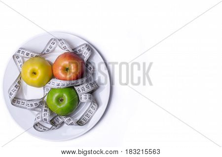 Concept Of Healthy Eating, Fresh Apples In A Plate And Measuring Tape, Isolated On White.