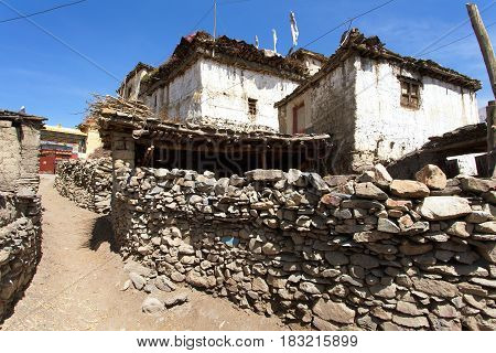 View of local stony building and wall in Jharkot village one of the best villages in round Annapurna circuit trekking trail route Lower Mustang Nepal