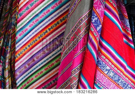 CUZCO PERU 08 FEBRUARY 2017: Colourful hand-made fabricks with traditional ornaments at the market